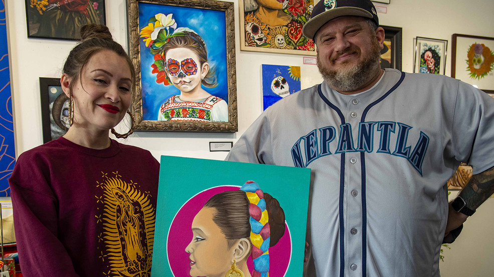 Jake and Judy with portrait of their daughter.jpg