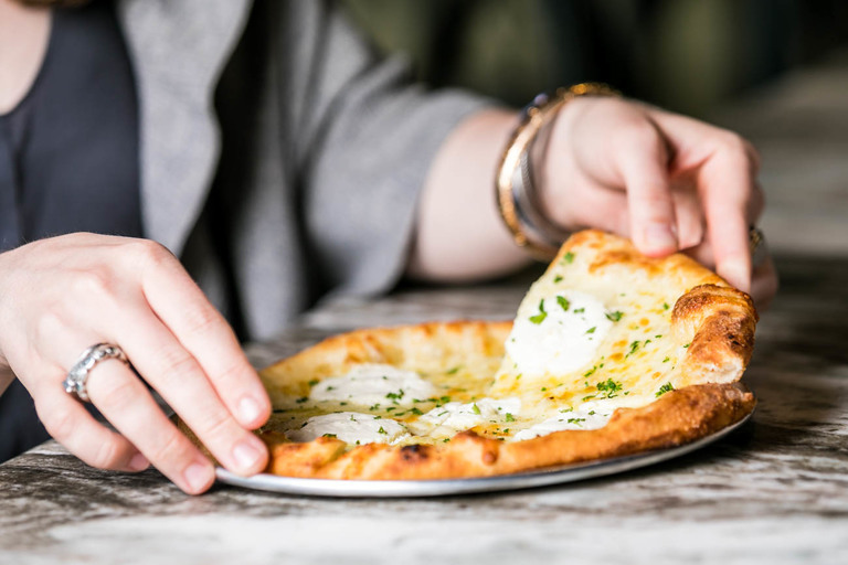 Bianco Pizza: extra-virgin olive oil, garlic, parsley, ricotta, and mozzarella / Image: Amy Elisabeth Spasoff // Published: 5.26.18