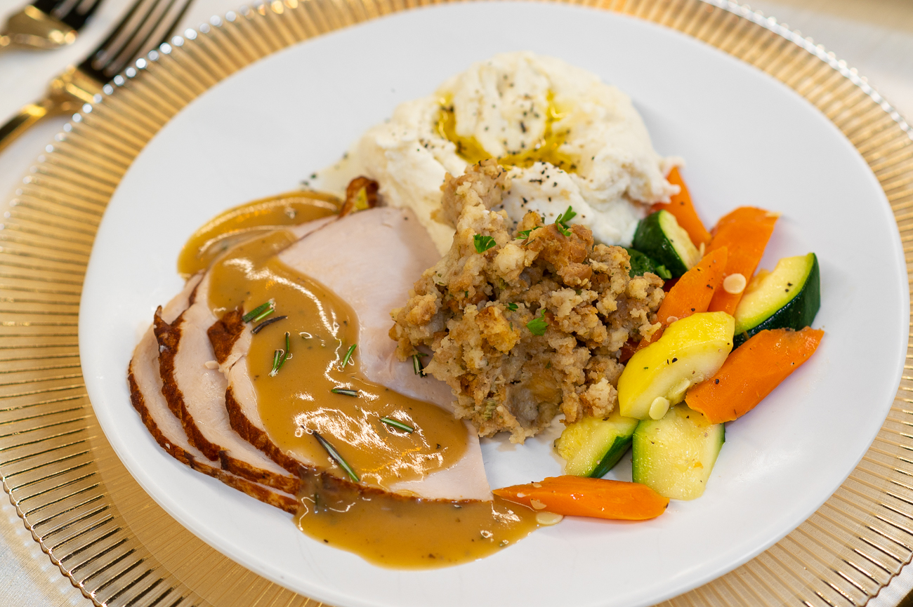 The Take and Bake Holiday Dinner. Pictured: oven-roasted turkey breast with rosemary sage sauce, seasonal vegetable medley, traditional holiday stuffing, and butter-whipped mashed potatoes. / Image: Phil Armstrong, Cincinnati Refined // Published: 11.6.20