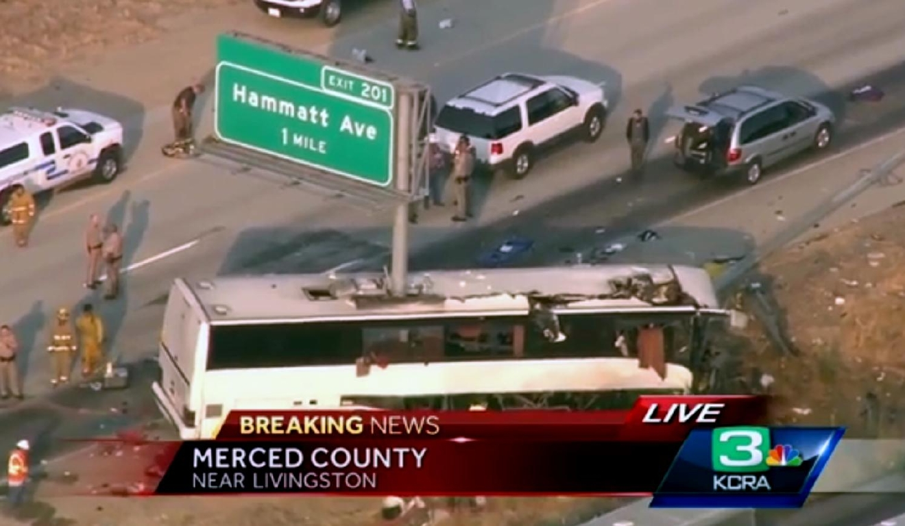 This still frame from video provided by KCRA3-TV shows authorities investigating the scene of a charter bus crash on northbound Highway 99 between Atwater and Livingston, Calif., Tuesday, Aug. 2, 2016. The bus veered off the central California freeway before dawn Tuesday and struck a pole that sliced the vehicle nearly in half, killing multiple people and sending at several others to hospitals, authorities said. (KCRA3-TV via AP)