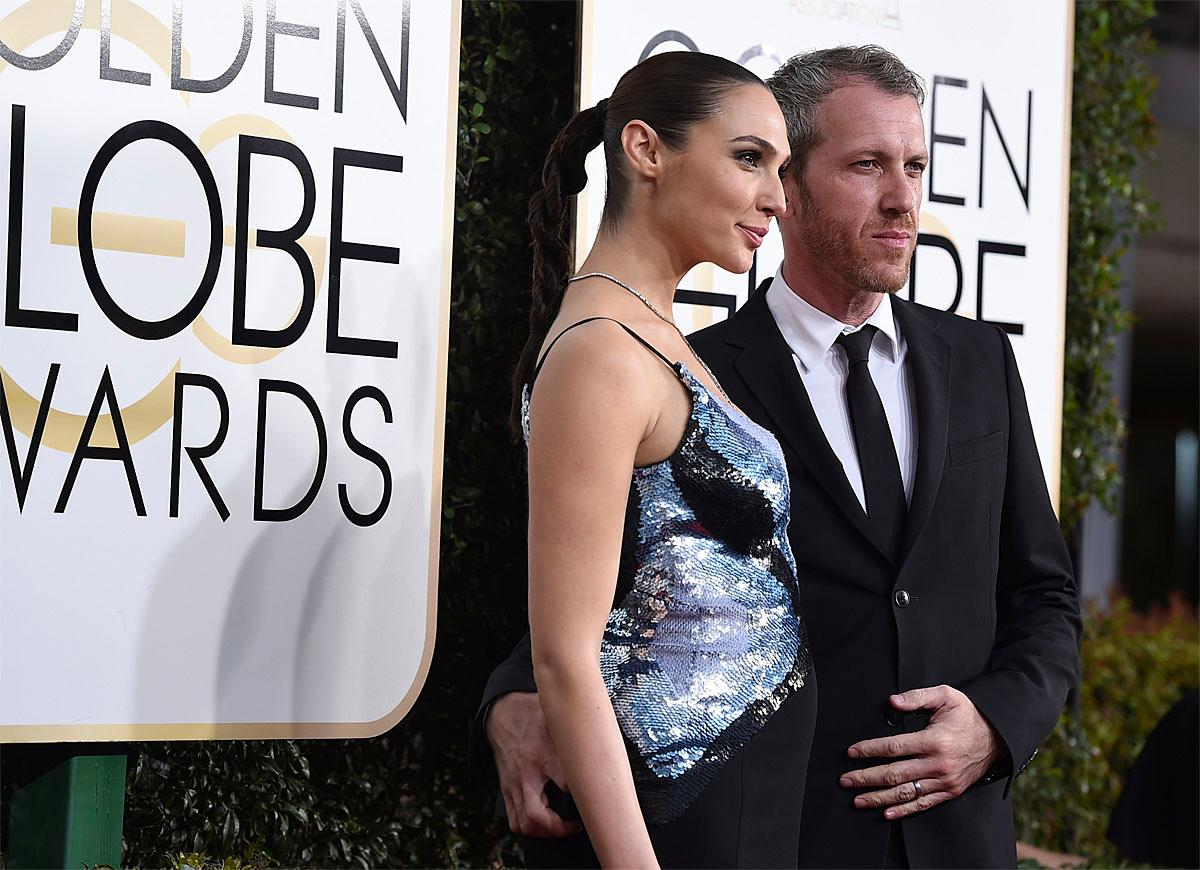 Gal Gadot, left, and Yaron Versano arrive at the 74th annual Golden Globe Awards at the Beverly Hilton Hotel on Sunday, Jan. 8, 2017, in Beverly Hills, Calif. (Photo by Jordan Strauss/Invision/AP)