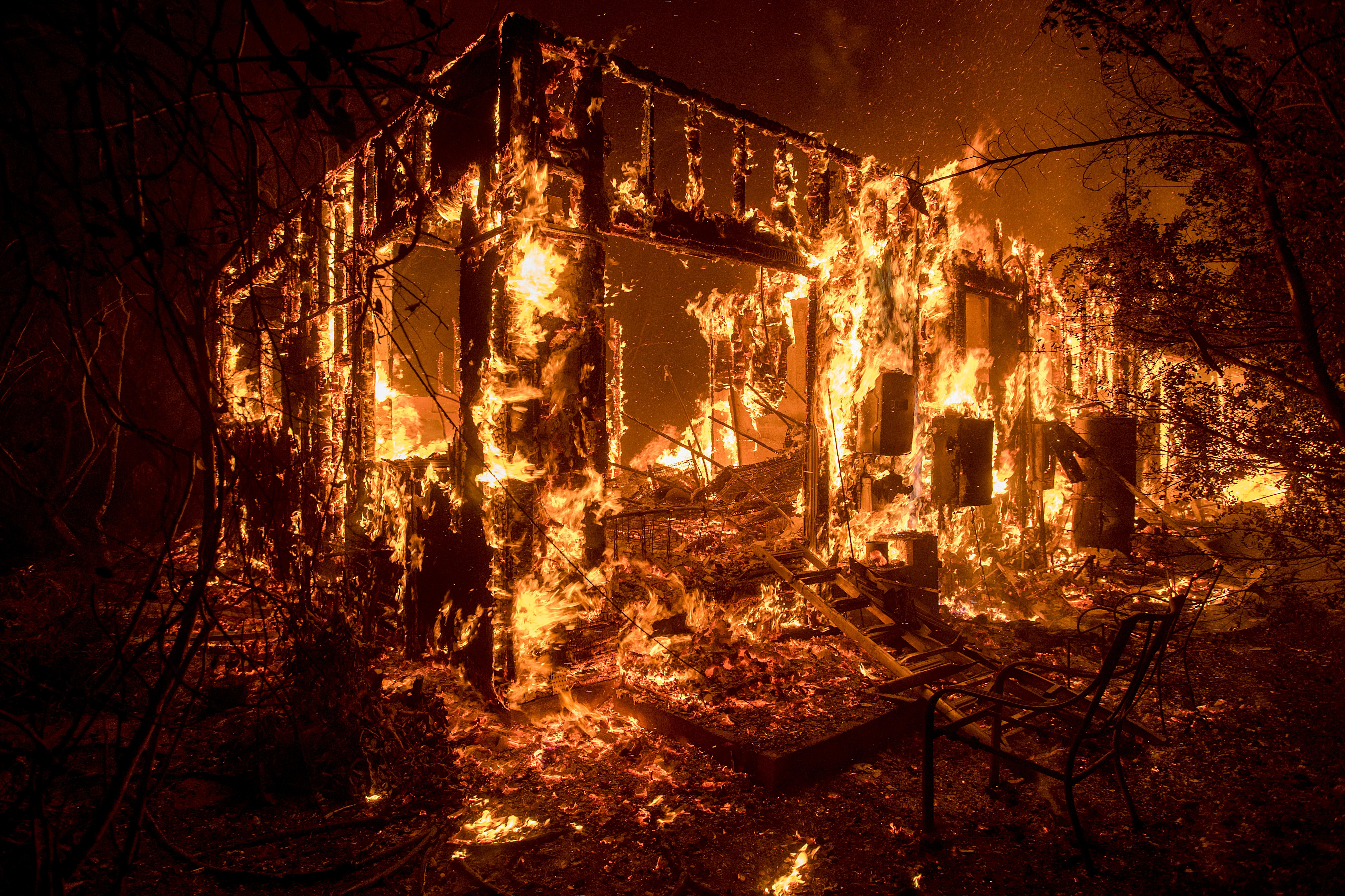 Flames consume a home as a wildfire burns in Ojai, Calif., on Thursday, Dec. 7, 2017. (AP Photo/Noah Berger)