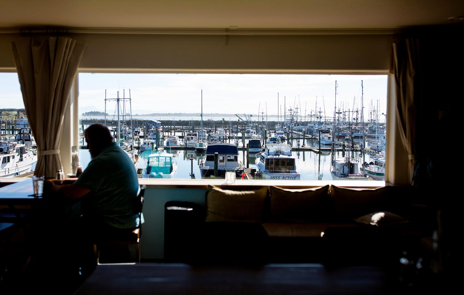 The view from the Salt Hotel and Pub looks over the fishing boats at the Port of Ilwaco. (Sy Bean / Seattle Refined)