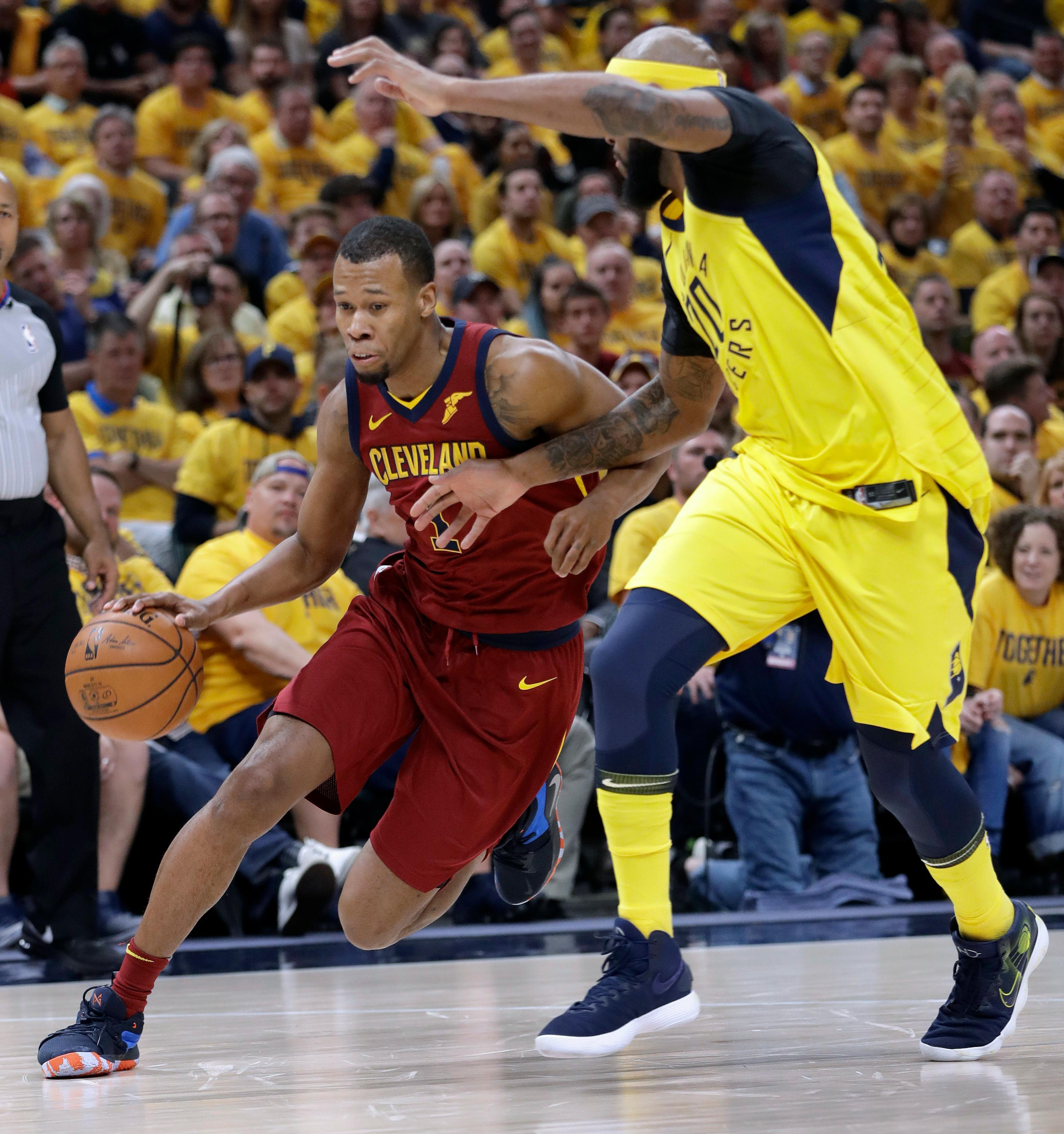 FILE - In this April 27, 2018, file photo, Cleveland Cavaliers' Rodney Hood, left, heads to the basket past Indiana Pacers' Trevor Booker during the first half of Game 6 of a first-round NBA basketball playoff series, in Indianapolis. A person familiar with the situation says the Cavaliers will not fine or suspend forward Rodney Hood for refusing to enter Game 4 against Toronto. The Athletic reported that Hood angered his teammates and others in the organization when he declined coach Tyronn Lue's request to replace LeBron James with 7:38 left and the Cavs leading by 30. Hood spoke to team officials about the incident Tuesday, May 8, 2018, and will not be disciplined, said the person who spoke to the Associated Press on condition of anonymity because of sensitivity.(AP Photo/Darron Cummings, File)