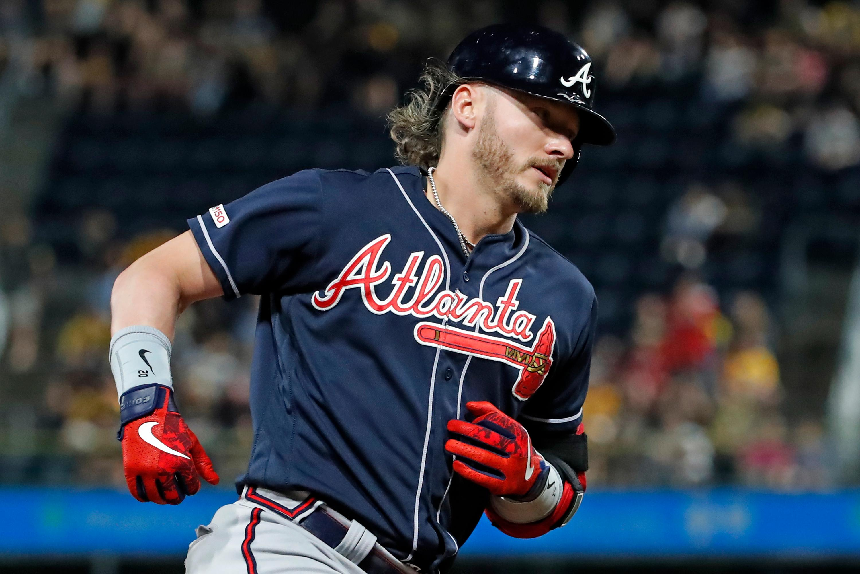 Atlanta Braves' Josh Donaldson rounds third after hitting a three-run home run off Pittsburgh Pirates relief pitcher Geoff Hartlieb during the eighth inning of a baseball game in Pittsburgh, Tuesday, June 4, 2019. (AP Photo/Gene J. Puskar)