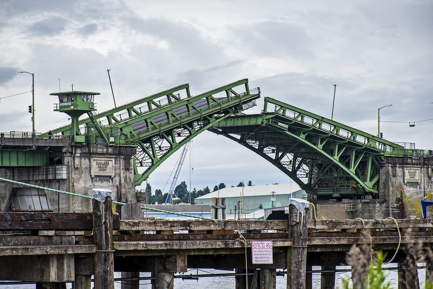 Also known as the 15th Avenue Bridge, the Ballard Bridge is a double-leaf bascule bridge situated over Seattle's Salmon Bay. Like the Fremont Bridge, the Ballard bridge opens frequently to allow tall boats to pass beneath.{ }(Image: Rachael Jones / Seattle Refined)
