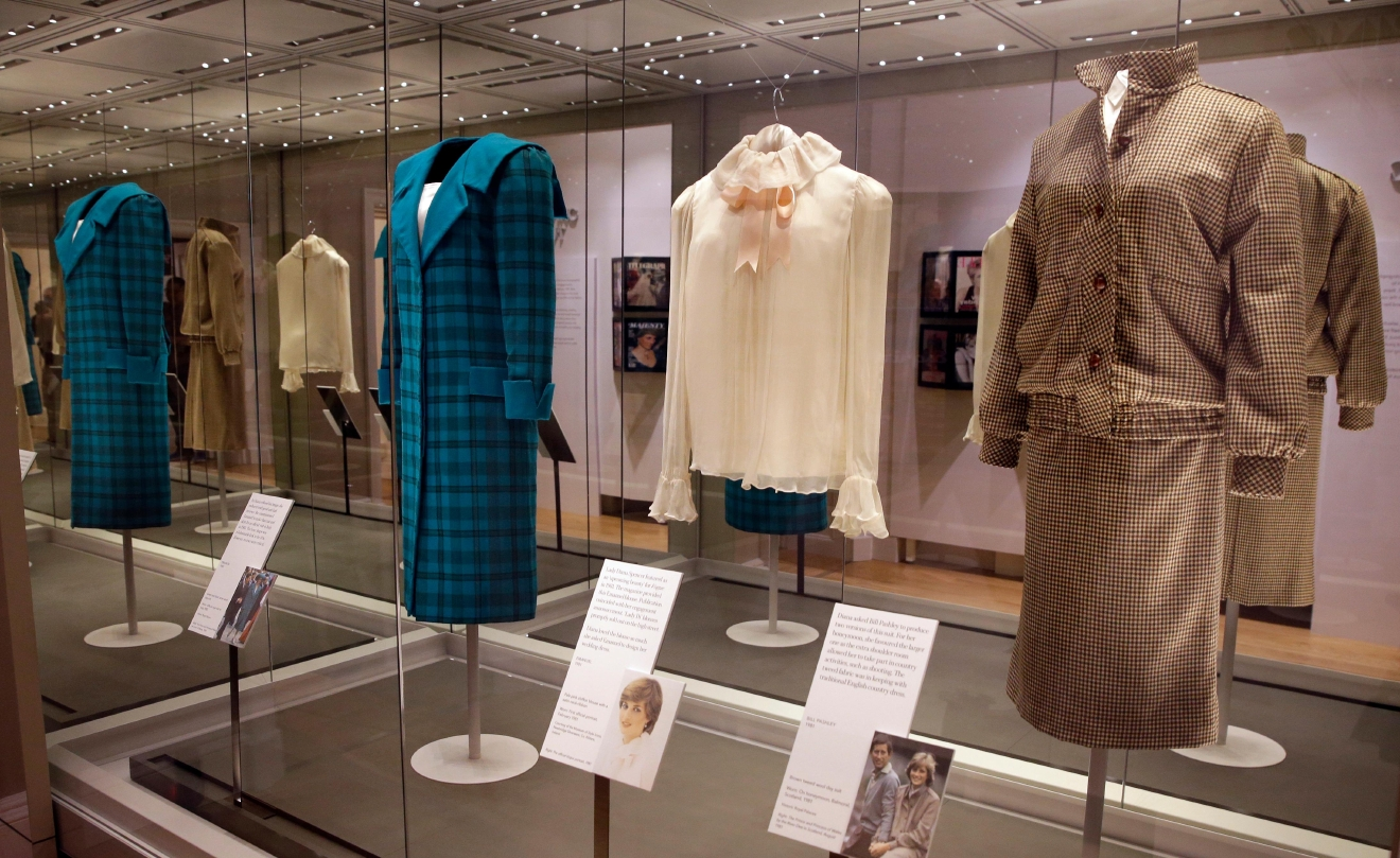 "A selection of coats and outfits worn by Diana, Princess of Wales, including at right, a brown tweed wool day suit by Bill Pashley, which she wore on her honeymoon in Scotland 1981, during a media preview of an exhibition of 25 dresses and outfits worn by Diana, Princess of Wales entitled ""Diana: Her Fashion Story"" at Kensington Palace in London, Wednesday, Feb. 22, 2017. (AP Photo/Alastair Grant)"