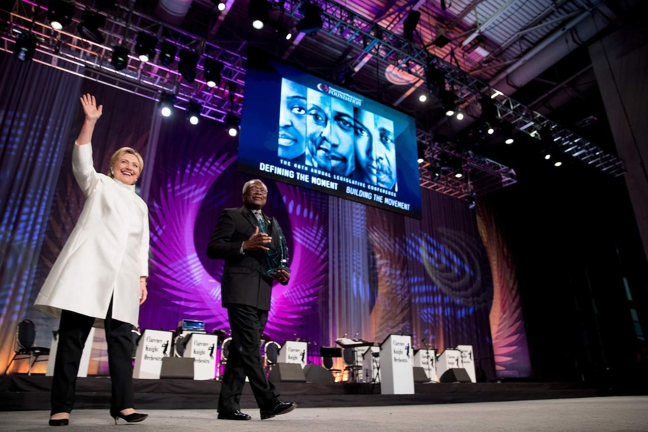 Democratic presidential candidate Hillary Clinton accompanied by James Clyburn, D-S.C., right, takes the stage to receive the Phoenix award at the Congressional Black Caucus Foundation's Phoenix Awards Dinner at the Washington Convention center, in Washington, Saturday, Sept. 17, 2016. (AP Photo/Andrew Harnik)