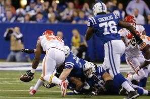 Kansas City Chiefs outside linebacker Justin Houston (50) recovers a fumble during the first half of an NFL wild-card playoff football game against the Indianapolis Colts Saturday, Jan. 4, 2014, in Indianapolis. (AP Photo/AJ Mast)