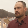 Buncombe County man says someone dropped brick from overpass onto his wife's vehicle