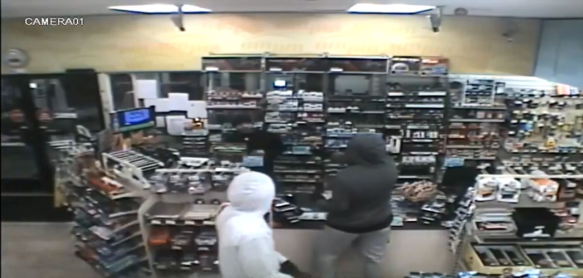 Screenshot from surveillance camera shows one of the two Seattle armed robberies. (Photo courtesy: Seattle Police Dept.)<p></p>