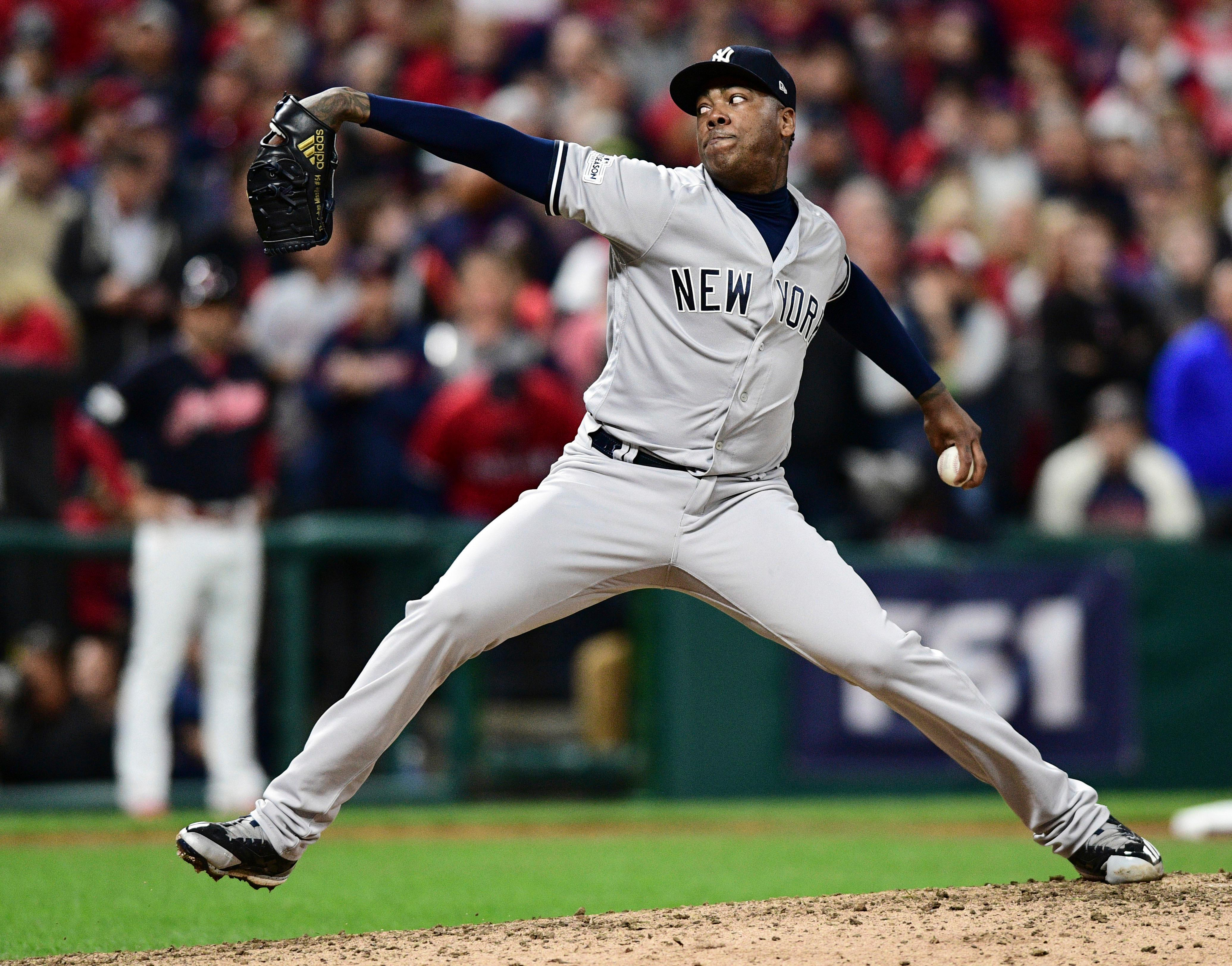 New York Yankees relief pitcher Aroldis Chapman delivers during the eighth inning against the Cleveland Indians in Game 5 of a baseball American League Division Series, Wednesday, Oct. 11, 2017, in Cleveland. (AP Photo/David Dermer)