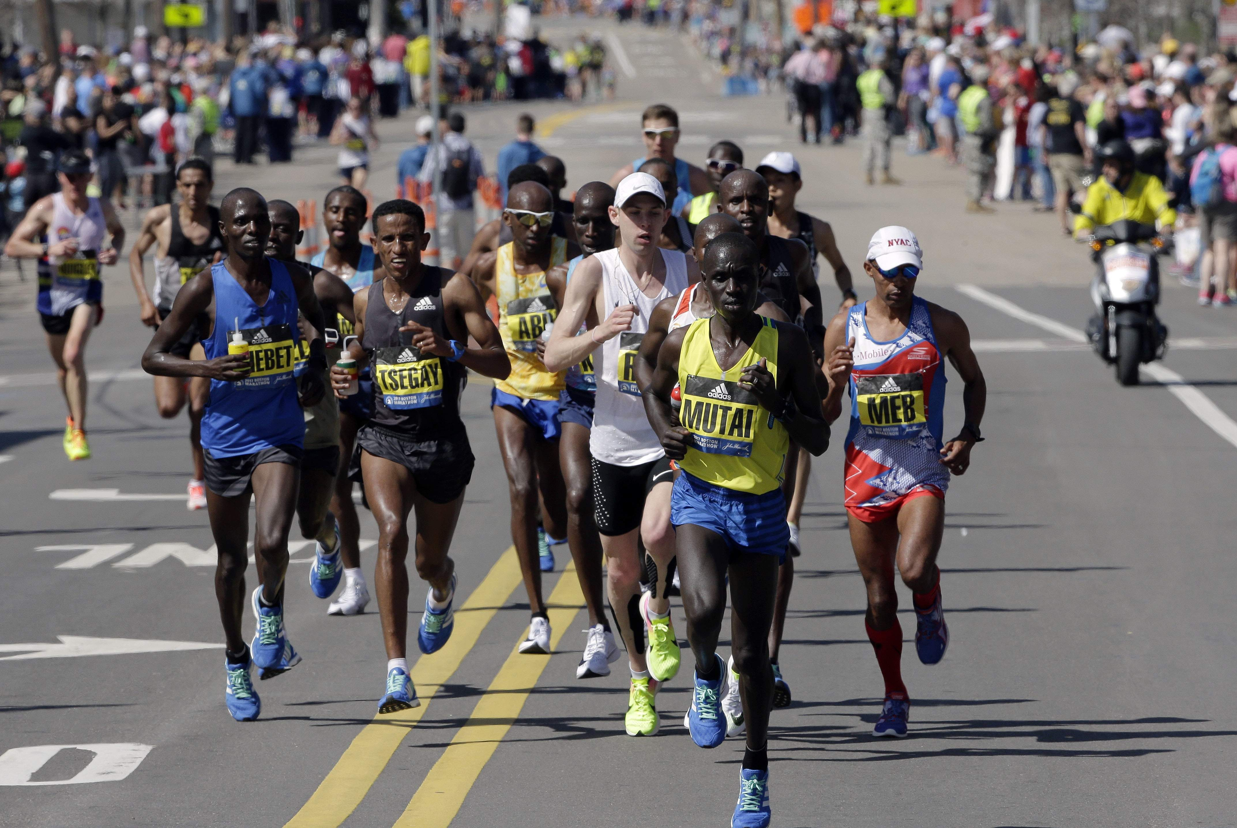 Emmanuel Mutai, of Kenya, leads the pack along the course of the 121st Boston Marathon on Monday, April 17, 2017, in Framingham, Mass. THE ASSOCIATED PRESS