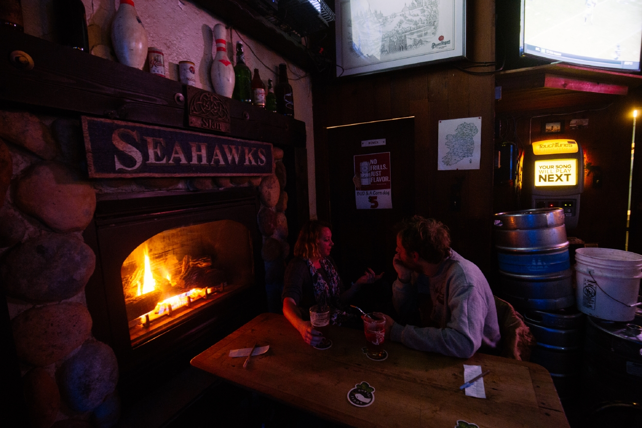 Cozy, bright and warm....Sully's on Queen Anne might just be our fav. Find it at 1625 Queen Anne Ave N, Seattle, WA 98109.   Brrr! We're hitting some real cold temps out there people. If you don't have a fireplace at home, hop on over to one of these bars and get warm (inside and out)! (Image: Joshua Lewis / Seattle Refined)
