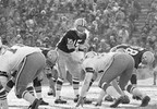 FILE - In this Dec. 31, 1967, file photo, Green Bay Packers quarterback Bart Starr calls signals in bitter cold as he led the Packers to a win over the Dallas Cowboys in Green Bay, Wisc. Fifty years later, players from the Packers and Cowboys still shiver from memories of the bitter cold of a game that would become known as the Ice Bowl.