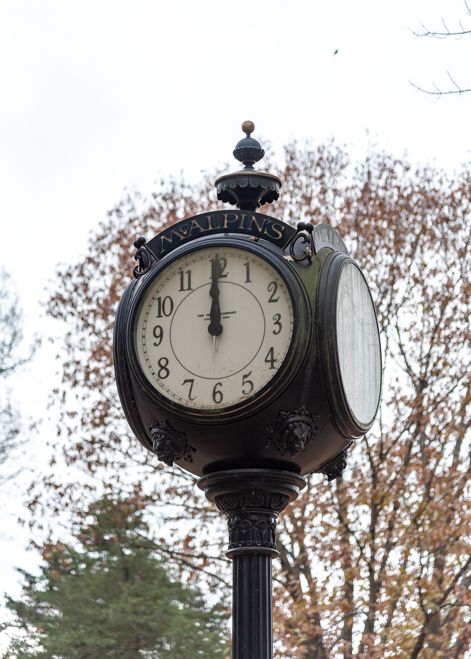 The Verdin Company installed the locally famous McAlpin's post clock on 4th Street in 1901. After McAlpin's closed in 1996, the clock was relocated to Heritage Village where it sits between Chester Station and Benedict Cottage.{ }/ Image: Phil Armstrong, Cincinnati Refined // Published: 12.5.19