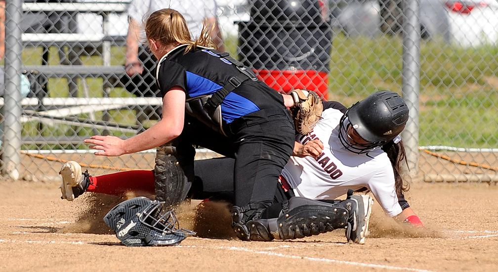 Andy Atkinson / Mail TribuneNorth's Ella Ivens slide under the tag from South's Cassidy Clark for a score in the 3rd inning.