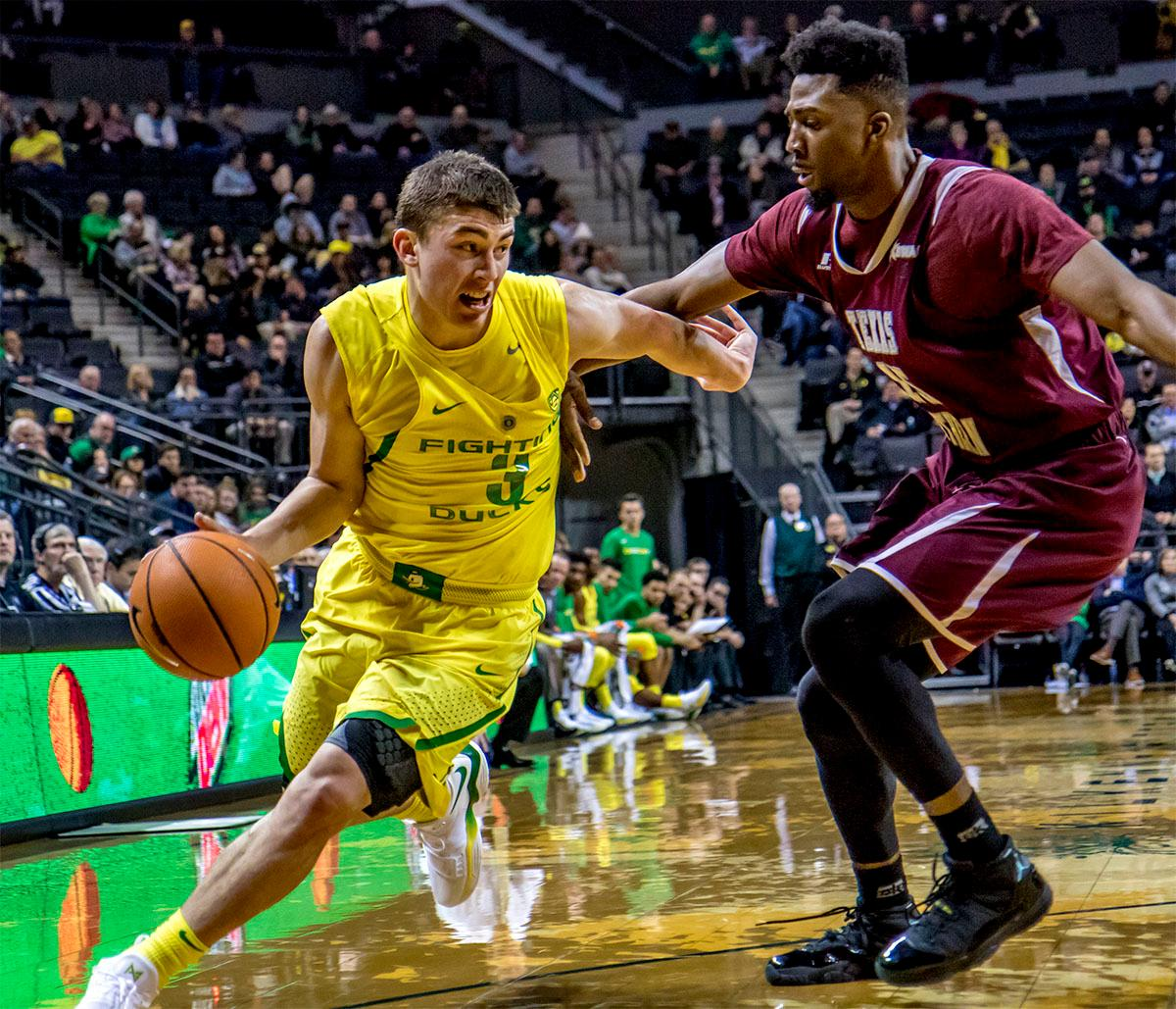 The Duck's Payton Pritchard (#3) looks for an opening past the Tigers. The Oregon Ducks defeated Texas Southern Tigers 74-68. The Ducks are now 7-3 overall in the Pac-12. Photo by August Frank. Oregon News Lab