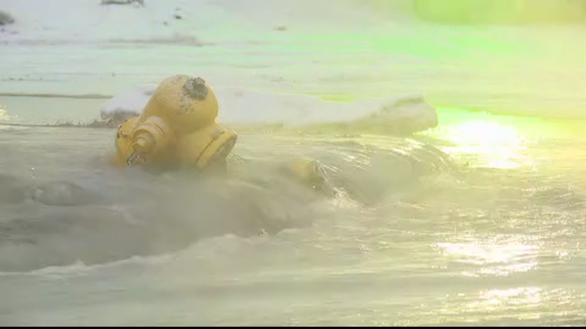 A fire hydrant in Burton has been knocked over and spraying water across a roadway. (WEYI/WSMH)