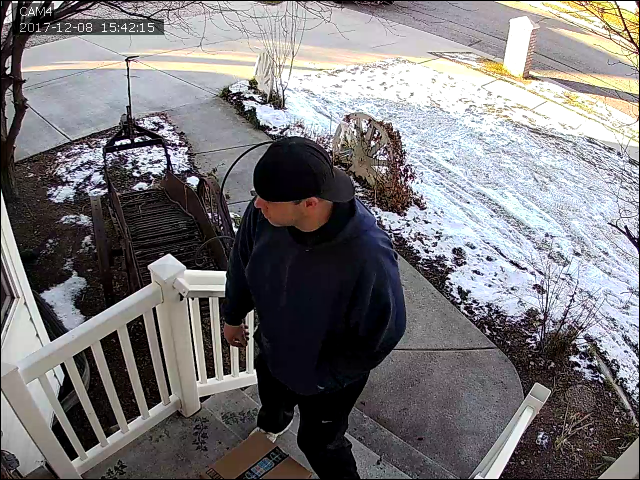 Thief caught on security camera stealing Christmas parcel from front door (Photo: Justin McFarland)