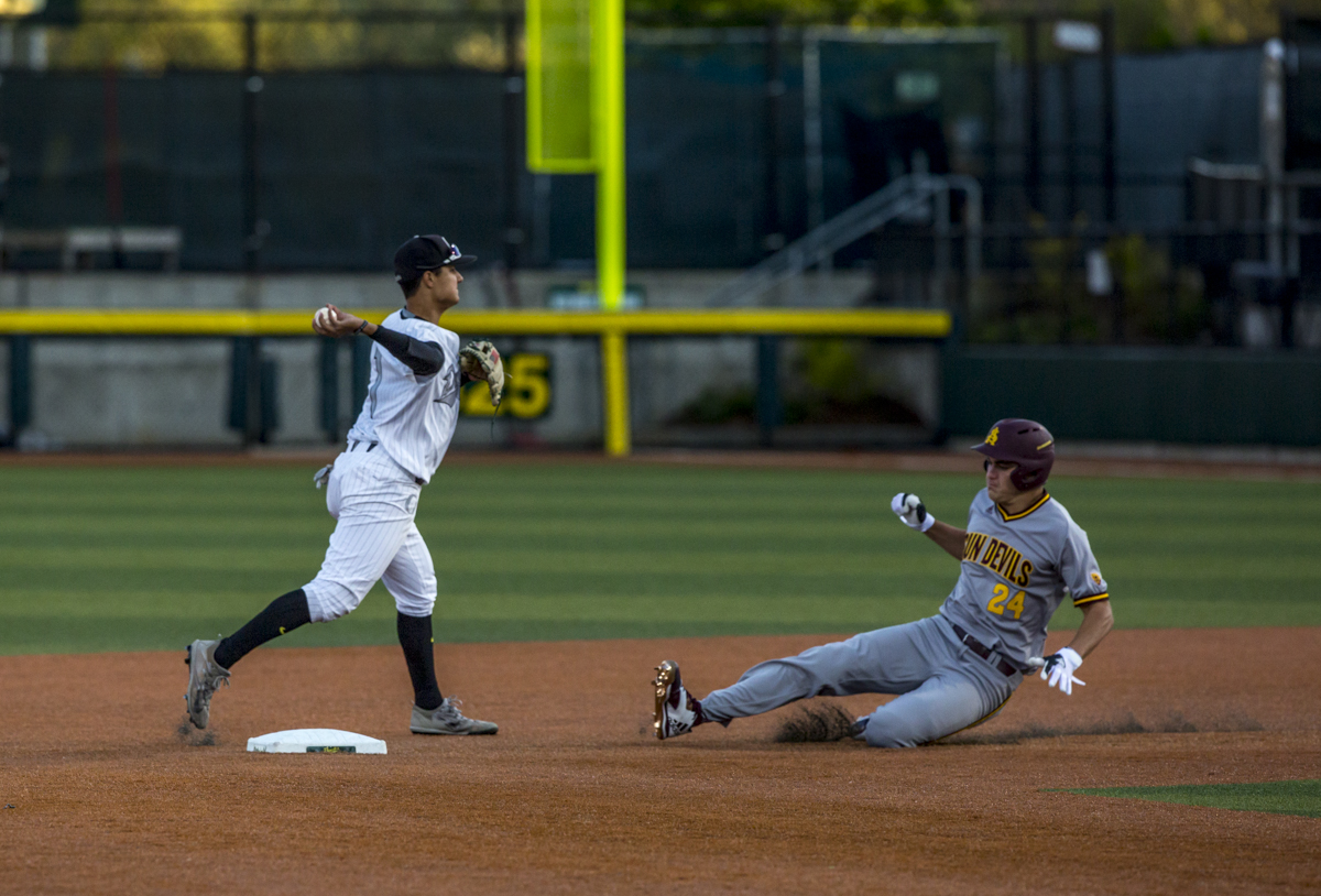 Oregon Ducks infielder Kyle Kasser (#1) tags out Arizona Sun Devils outfielder Hunter Bishop (#24) before pulling off a double play. The Oregon Ducks defeated the Arizona State Sun Devils 2-0 in the first game of a three game series Friday evening at PK Park in Eugene, Oregon. Photo by Duncan Moore, Oregon News Lab.