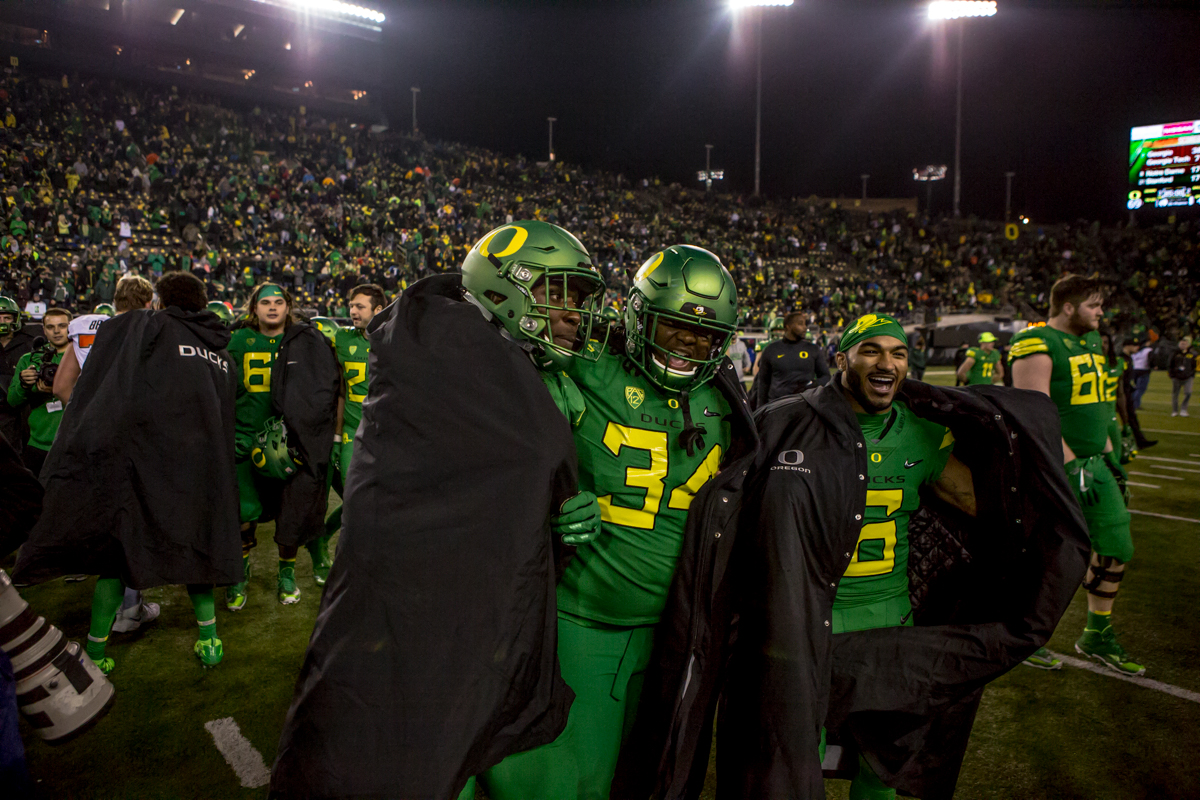 Oregon players celebrate their win at the end of the game. The Oregon Ducks defeated the Oregon State Beavers 69 to 10 in the 121st Civil War game at Autzen Stadium in Eugene, Ore. on Saturday November 25, 2017. Photo by Ben Lonergan, Oregon News Lab