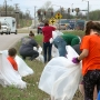 Coweta volunteers ban together to clean up city