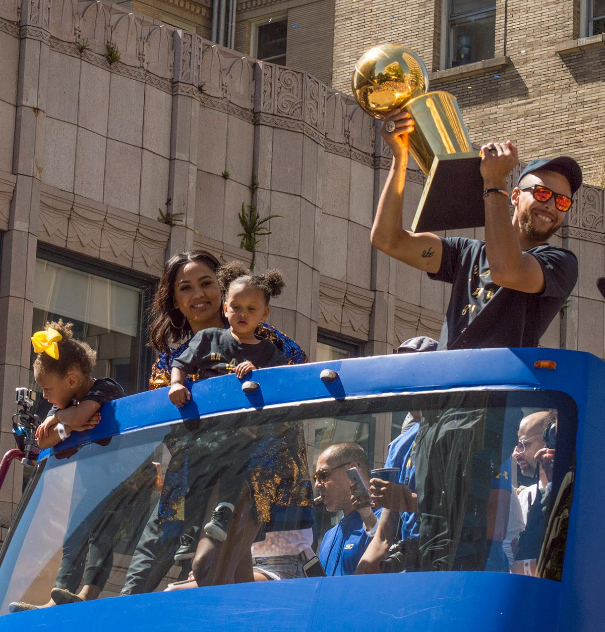The crowd of fans cheers as Stephen Curry holds the 2017 NBA Championship trophy during the Golden State Warriors victory parade in Oakland, California. Photo by Emily Gonzalez, Oregon News Lab.