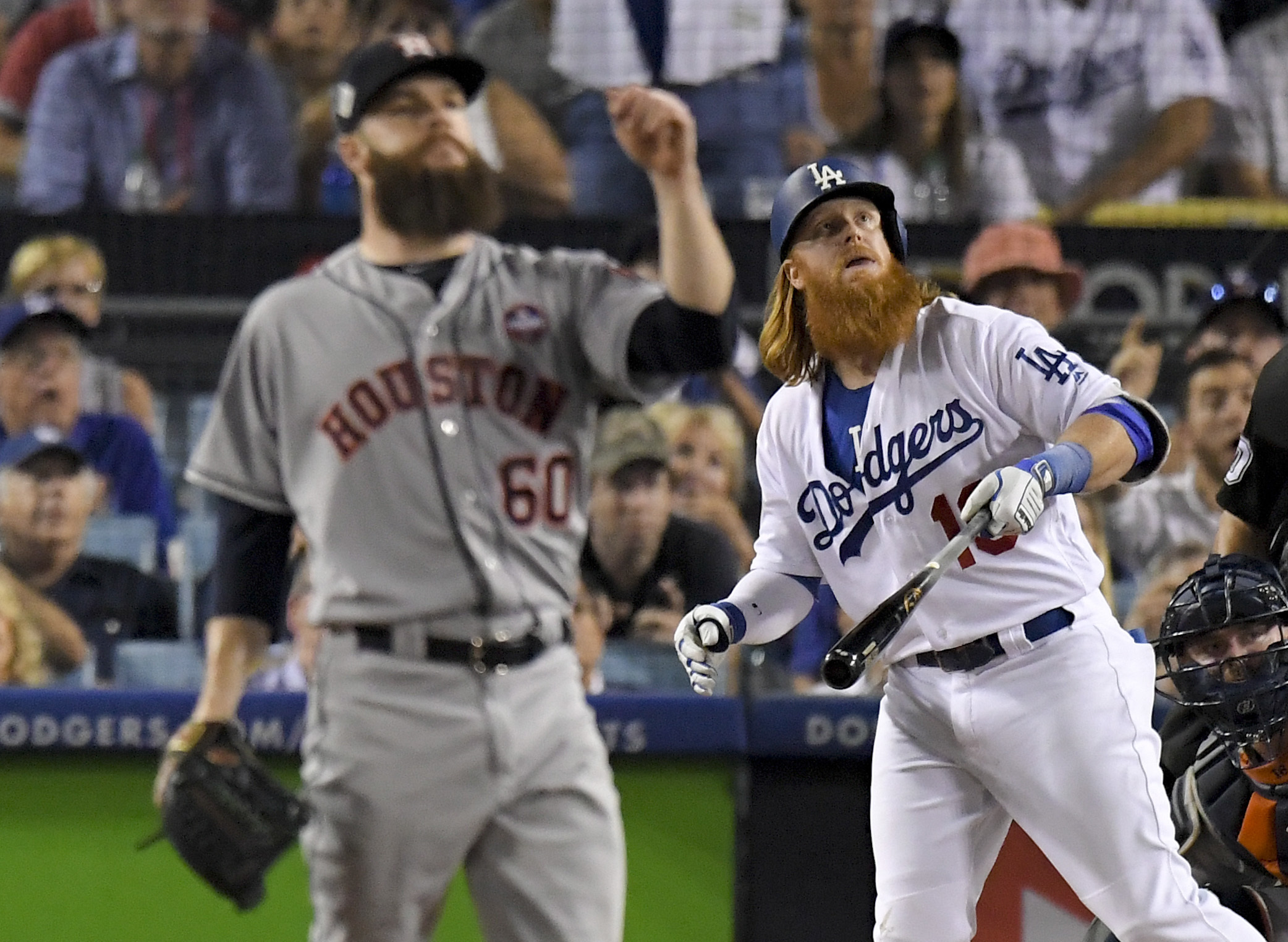 Los Angeles Dodgers' Justin Turner watches his two-run home run off Houston Astros starting pitcher Dallas Keuchel during the sixth inning of Game 1 of baseball's World Series Tuesday, Oct. 24, 2017, in Los Angeles. (AP Photo/Mark J. Terrill)