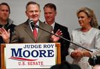 U.S. Senate candidate Roy Moore speaks as his wife Kayla Moore, right, listens at the RSA activity center, Tuesday, Dec. 12, 2017, in Montgomery, Ala.