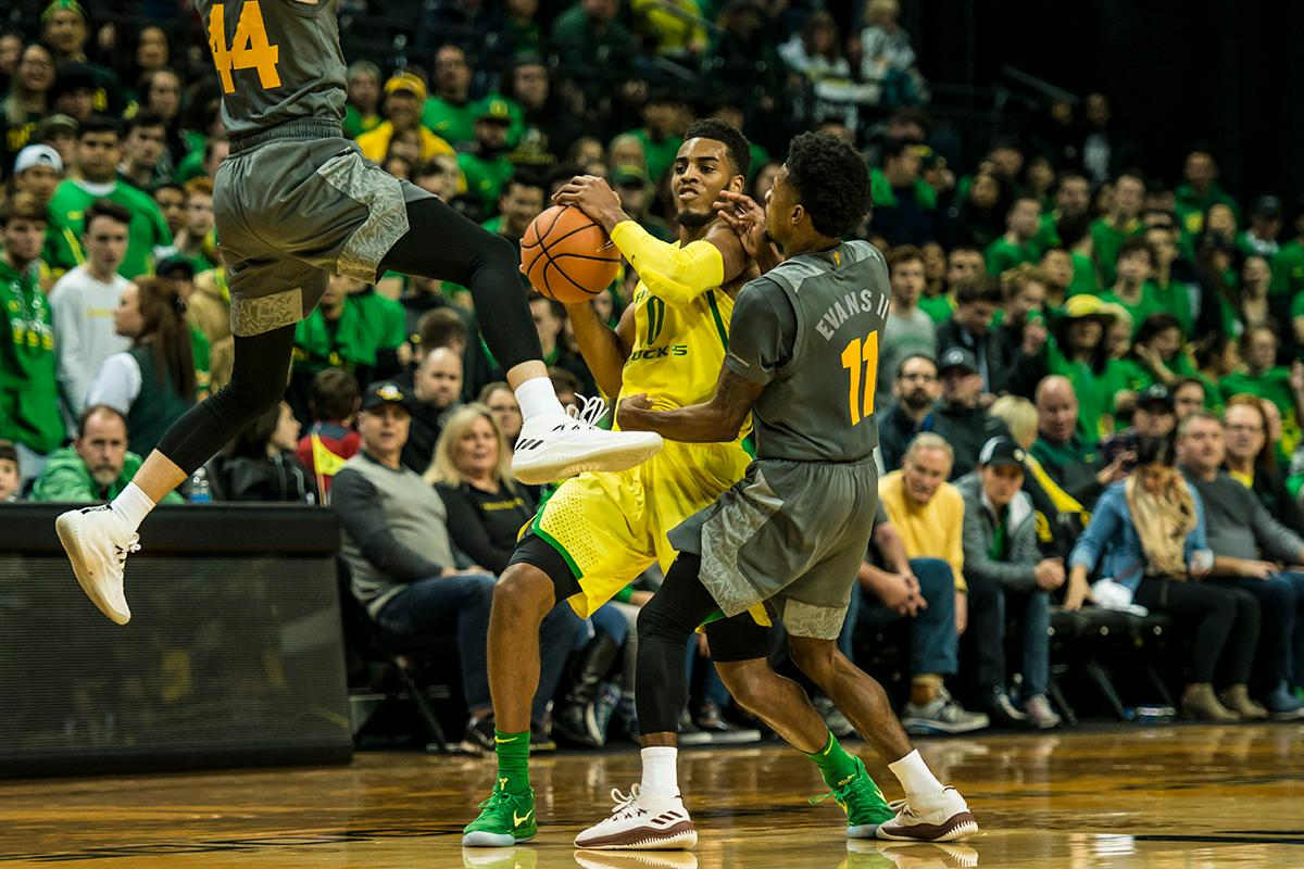 Oregon's is fouled by ASU defenders in their matchup Thursday at Matthew Knight Arena. Oregon defeated ASU 75-68 to improve their season record to 18-10 (8-7 PAC-12). The Ducks face off against fourteenth ranked Arizona for their final home game of the season at Matthew Knight Arena on Saturday. (Photo by Colin Houck)