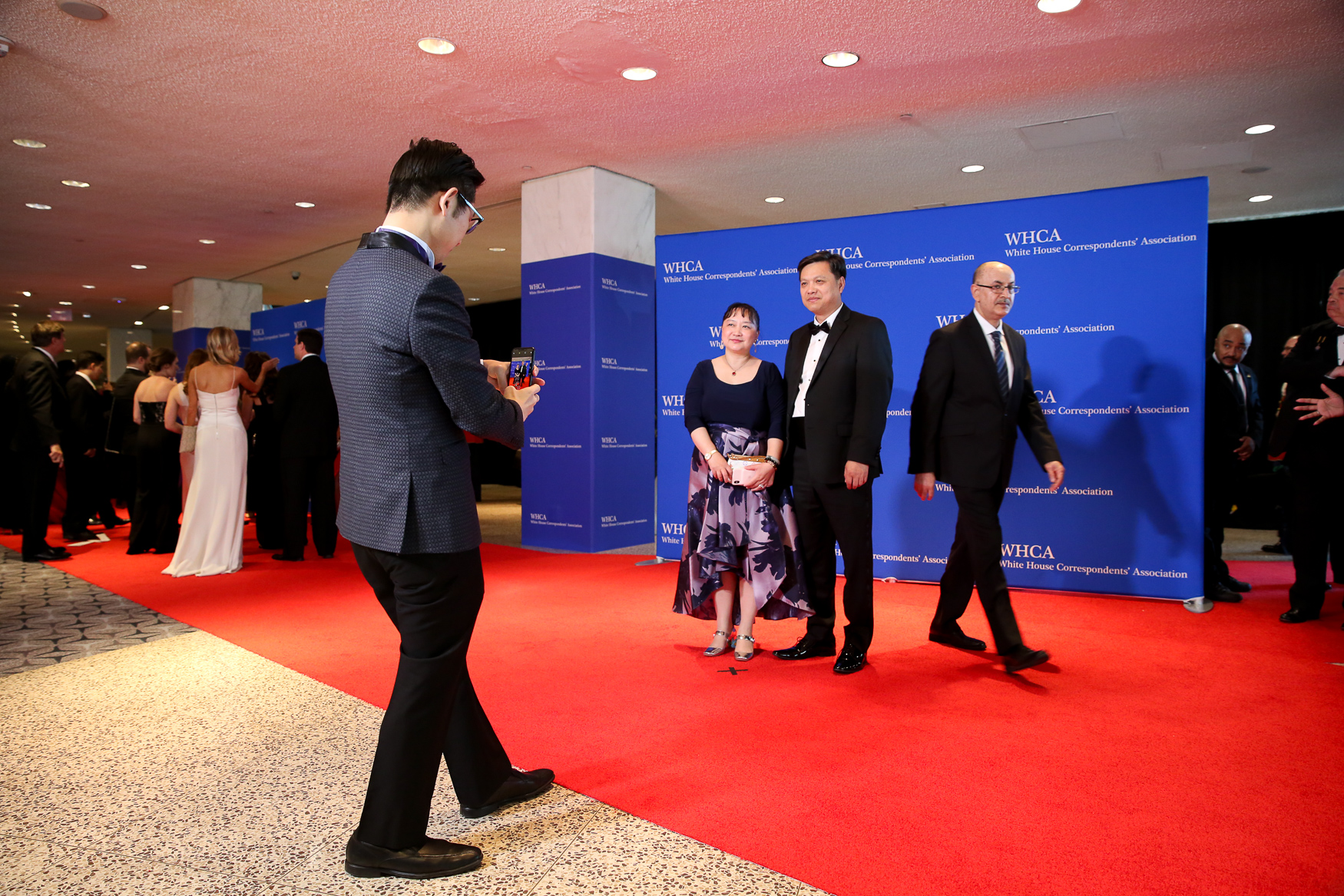 The guest list of 2019 White House Correspondents' Dinner was mostly populated by journalists and lesser-known celebrities, a far cry from years past, but dozens of people{ } still strutted down the red carpet. Notably missing President Donald Trump and members of his administration, but Trump has broken from tradition by skipping the dinner throughout his presidency. Another key difference in this year's festivities is that the dinner's entertainment is historian Ron Chernow - typically the dinner's entertainment is led by a comedian. (Amanda Andrade-Rhoades/DC Refined)