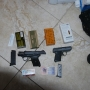 Police seize multiple drugs, weapons during early morning raid
