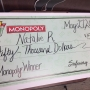 Eugene woman receives $50,000 check after playing collect-and-win Monopoly game