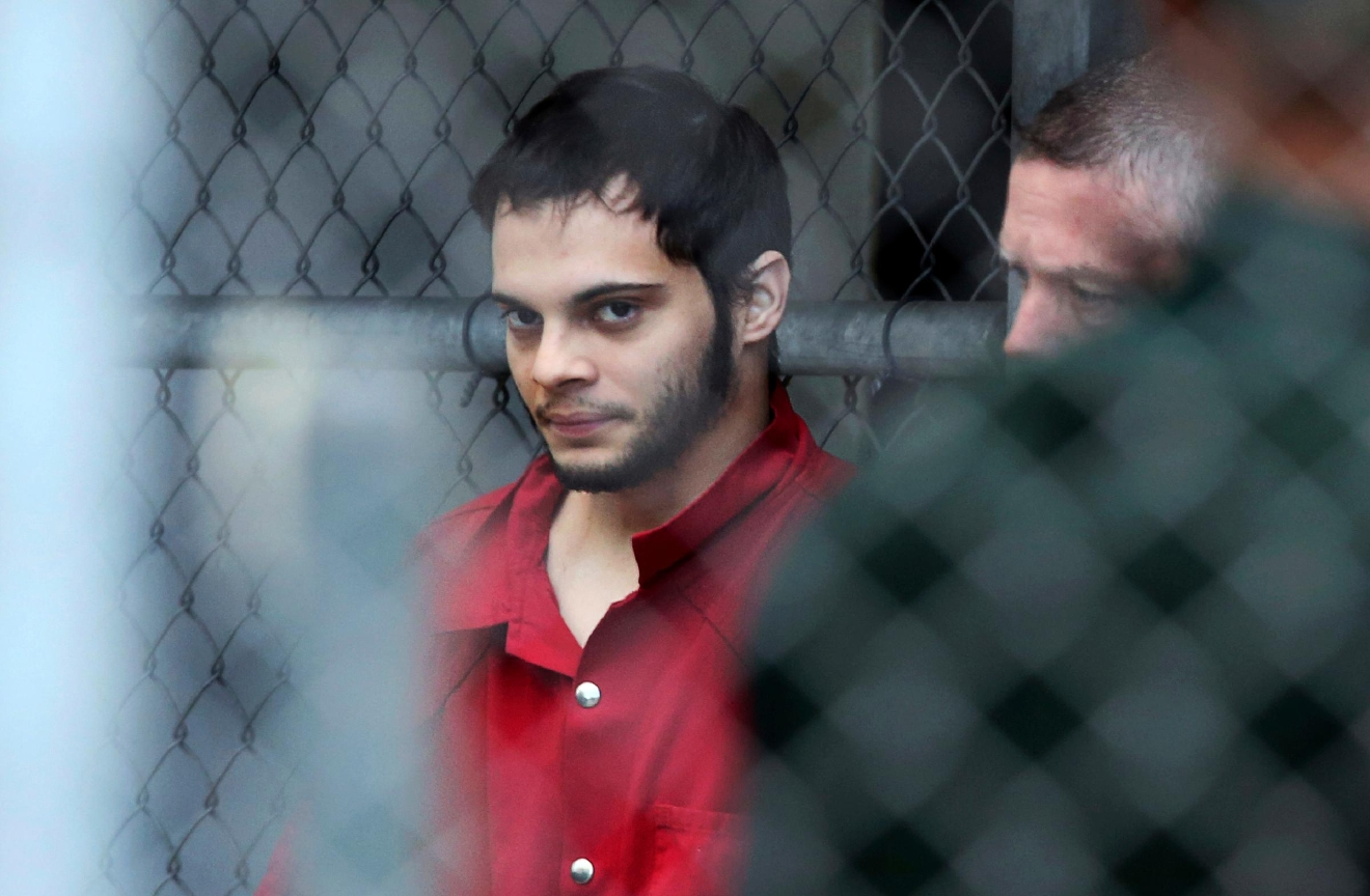 FILE- In this Jan. 9, 2017, file photo, Esteban Santiago is taken from the Broward County main jail as he is transported to the federal courthouse in Fort Lauderdale, Fla. (Amy Beth Bennett/South Florida Sun-Sentinel via AP, File)<p></p>