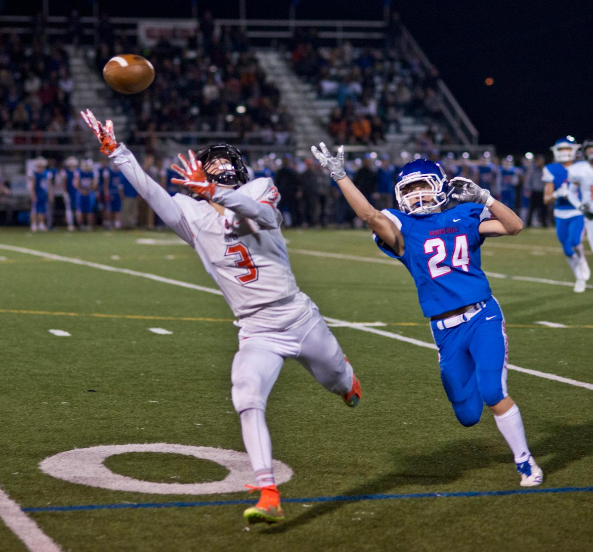 Crater Comets wide receiver Bailee Robles (#3) attempts to haul in a long pass as Churchill Lancers defensive back Evan Powell (#24) is unable to tip the ball. Churchill defeated Crater 63-21 on Friday at their homecoming game. Churchill remains undefeated with a conference record of 9-0. Photo by Dan Morrison, Oregon News Lab