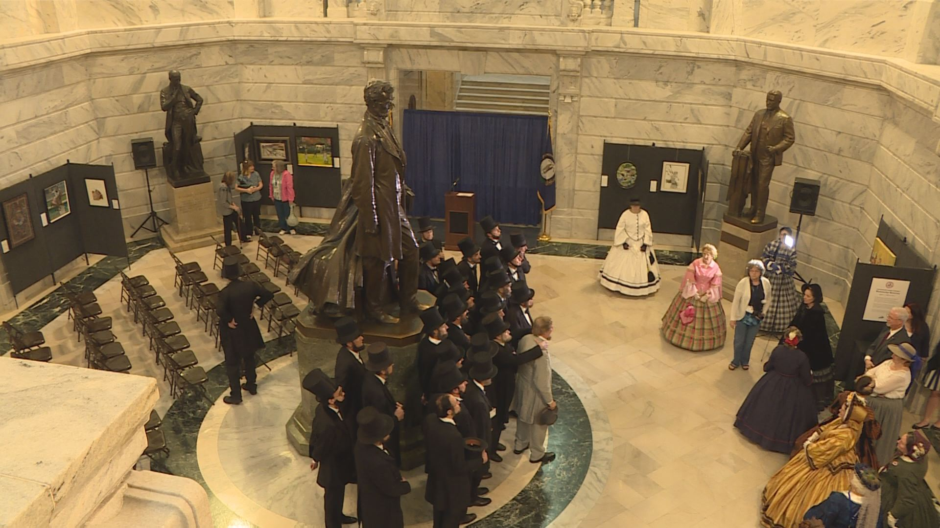 Members of the Association of Lincoln Presenters posed with the statue in the Capitol rotunda, as Mary Lincoln presenters looked on.