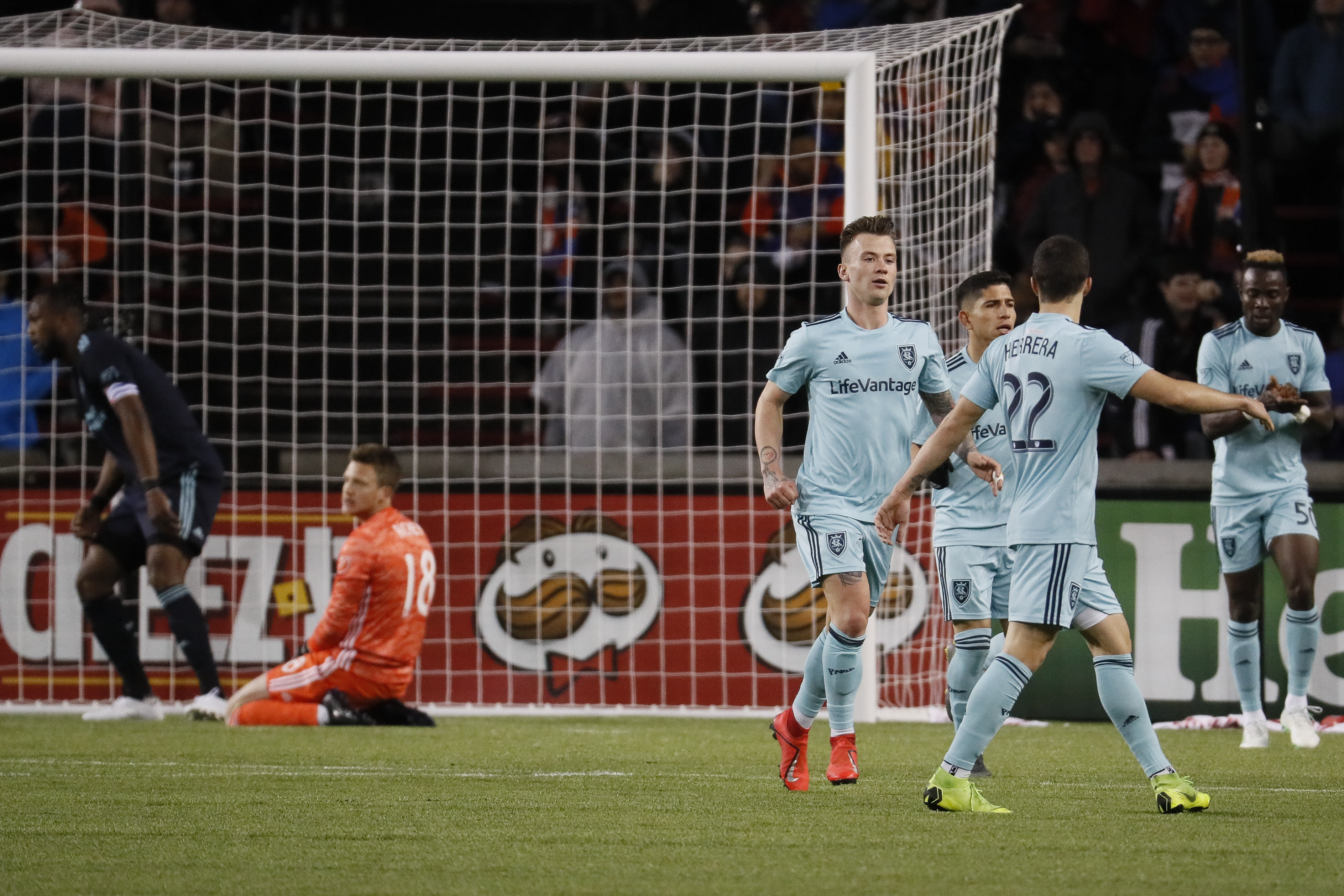 Real Salt Lake midfielder Albert Rusnak, center, celebrates with his teammates after scoring during the first half of an MLS soccer match against FC Cincinnati, Friday, April 19, 2019, in Cincinnati. (AP Photo/John Minchillo)