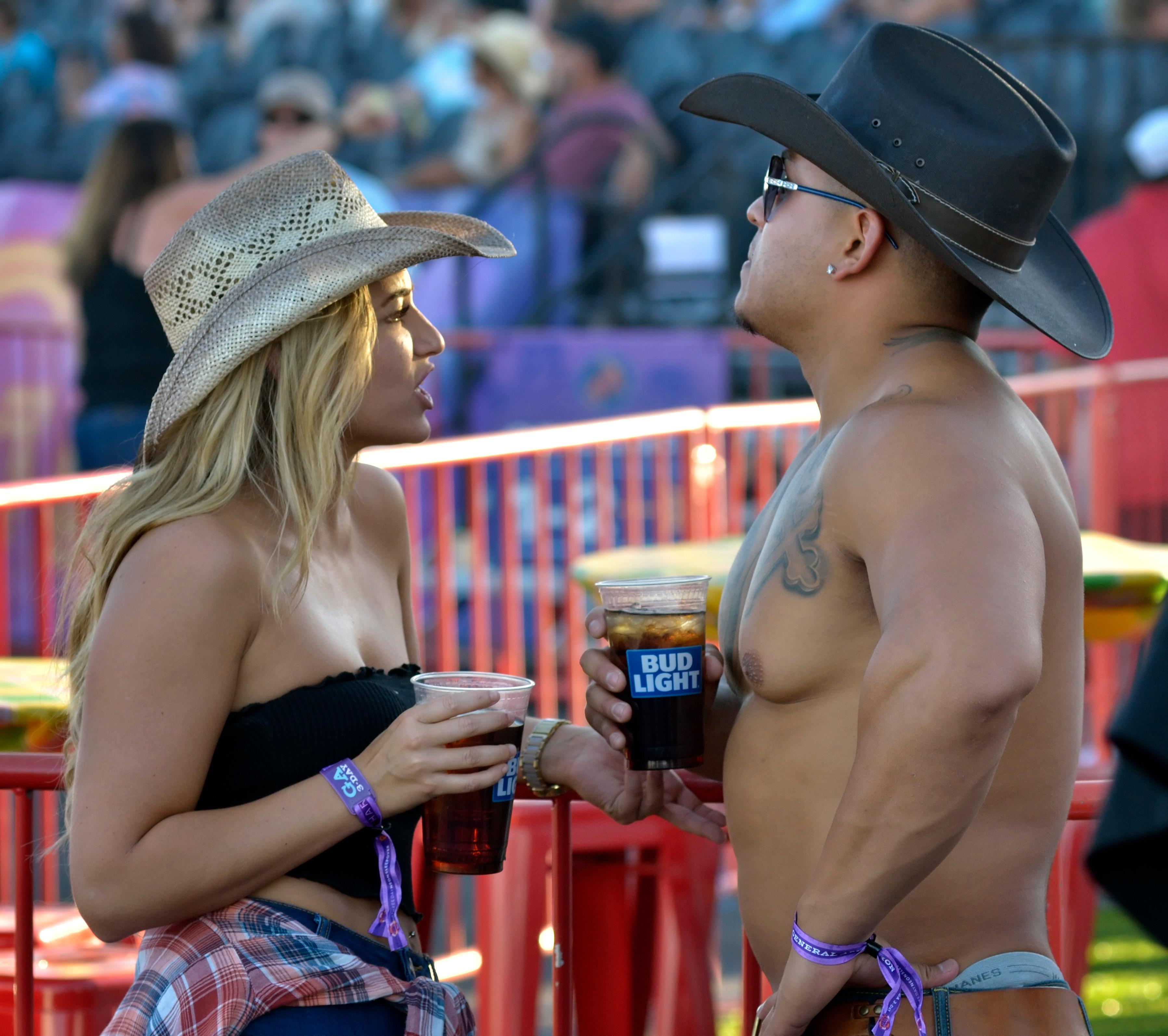 Brittany Ryan and Adam Sanchez chat during the Route 91 Harvest festival on Las Vegas Boulevard South in Las Vegas on Saturday, Sept. 30, 2017.  [Bill Hughes/Las Vegas News Bureau]