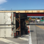 Tractor-trailer overturns on Route 30, driver taken to hospital