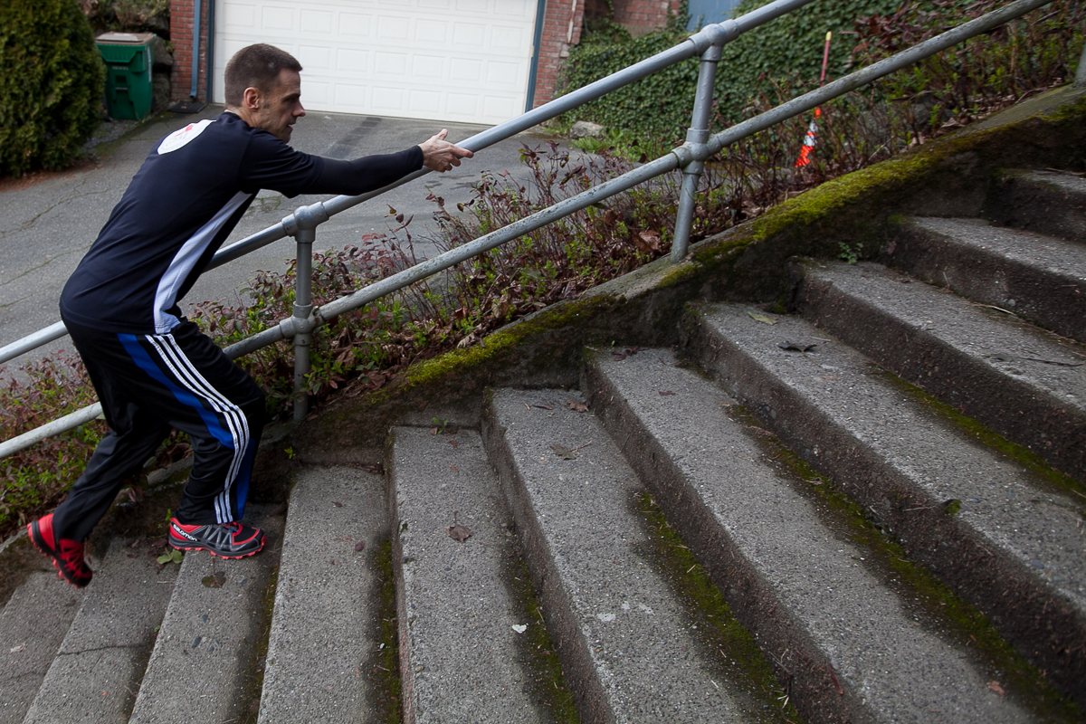 You might not think about it, but using the rail can dramatically help your stair workout, and it's not cheating like you might think. Use the hand-over-hand motion to keep up speed, and help with the different gait stair-climbing demands. (Image: Joshua Lewis / Seattle Refined)