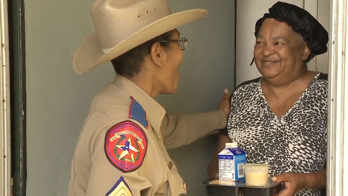 DPS troopers serve hot meals to local residents