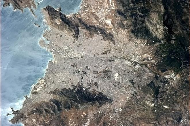 Athens, Greece, with the reflecting sun showing the wind on the water. (Photo & Caption: Col. Chris Hadfield, NASA)