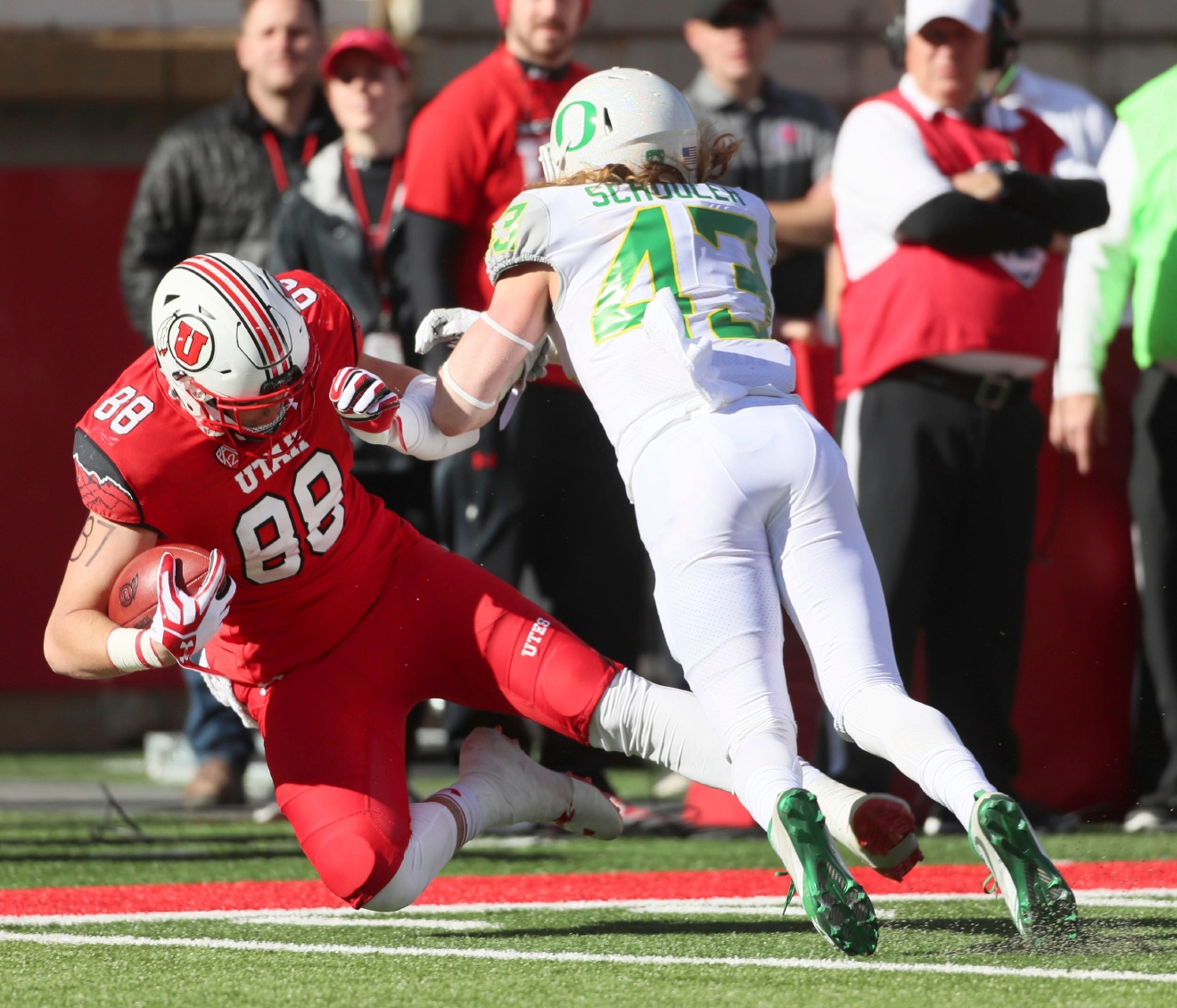 Utah tight end Harrison Handley (88) is hit and tackled by Oregon safety Brenden Schooler (43) in the first half during an NCAA college football game, Saturday, Nov. 19, 2016, in Salt Lake City. (AP Photo/George Frey)