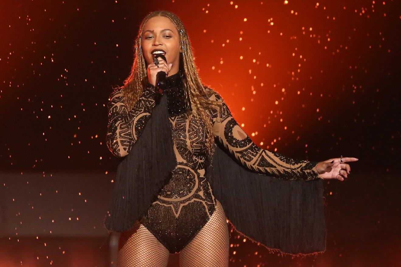 "FILE - In this June 26, 2016 file photo, Beyonce performs 'Freedom' at the BET Awards in Los Angeles. Beyonce and Adele are the top nominees at the MTV Video Music Awards, where their music videos will compete against Kanye West's controversial ""Famous"" for video of the year. The VMAs will air live Aug. 28 from New York's Madison Square Garden. (Photo by Matt Sayles/Invision/AP, File)"