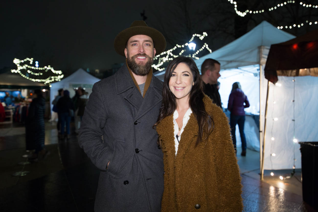 Mark Farris and Dakotah Romeo stayed warm and fashionable at the City Flea Holiday Market in Washington Park on Saturday, December 15. / Image: Catherine Viox // Published: 1.3.19