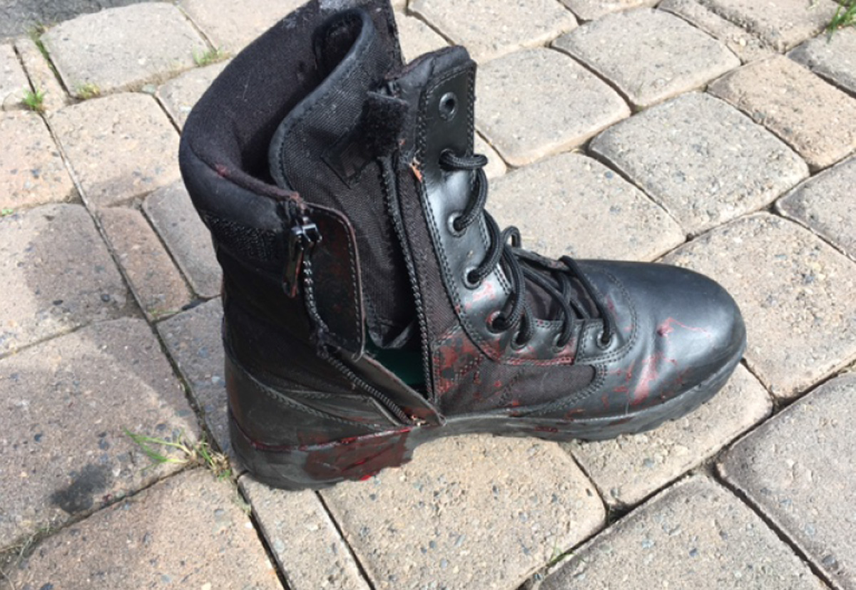 Blood spatters are seen{&amp;nbsp;}on the driver's boot.  (Photo from Pierce County Sheriff's Office)<p></p>