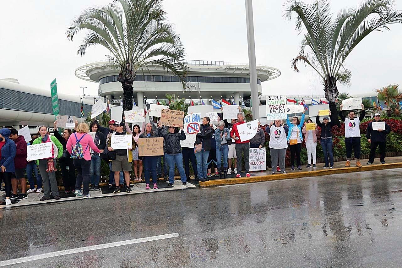Protesters rally against President Trump's refugee ban at Miami International Airport on Sunday, Jan. 29, 2017. President Donald Trump's immigration order sowed more confusion and outrage across the country Sunday, with travelers detained at airports, panicked families searching for relatives and protesters registering their opposition to the sweeping measure. (C.M. Guerrero/El Nuevo Herald via AP)