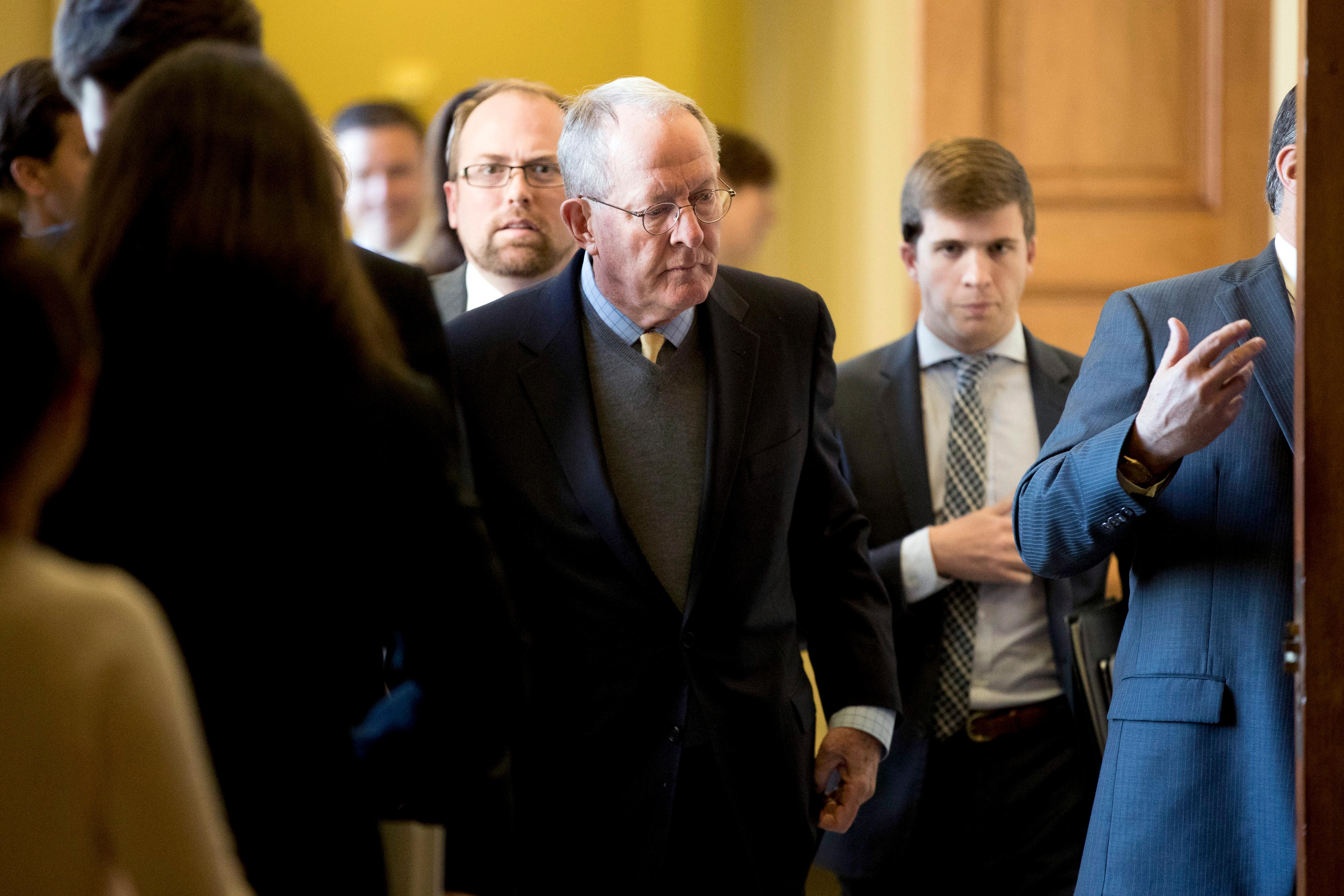 "Sen. Lamar Alexander, R-Tenn., center, leaves a Senate policy luncheon on Capitol Hill in Washington, Tuesday, Oct. 17, 2017, after he and Sen. Patty Murray, D-Wash., say they have the ""basic outlines"" of a bipartisan deal to resume payments to health insurers that President Donald Trump has blocked. (AP Photo/Andrew Harnik)"