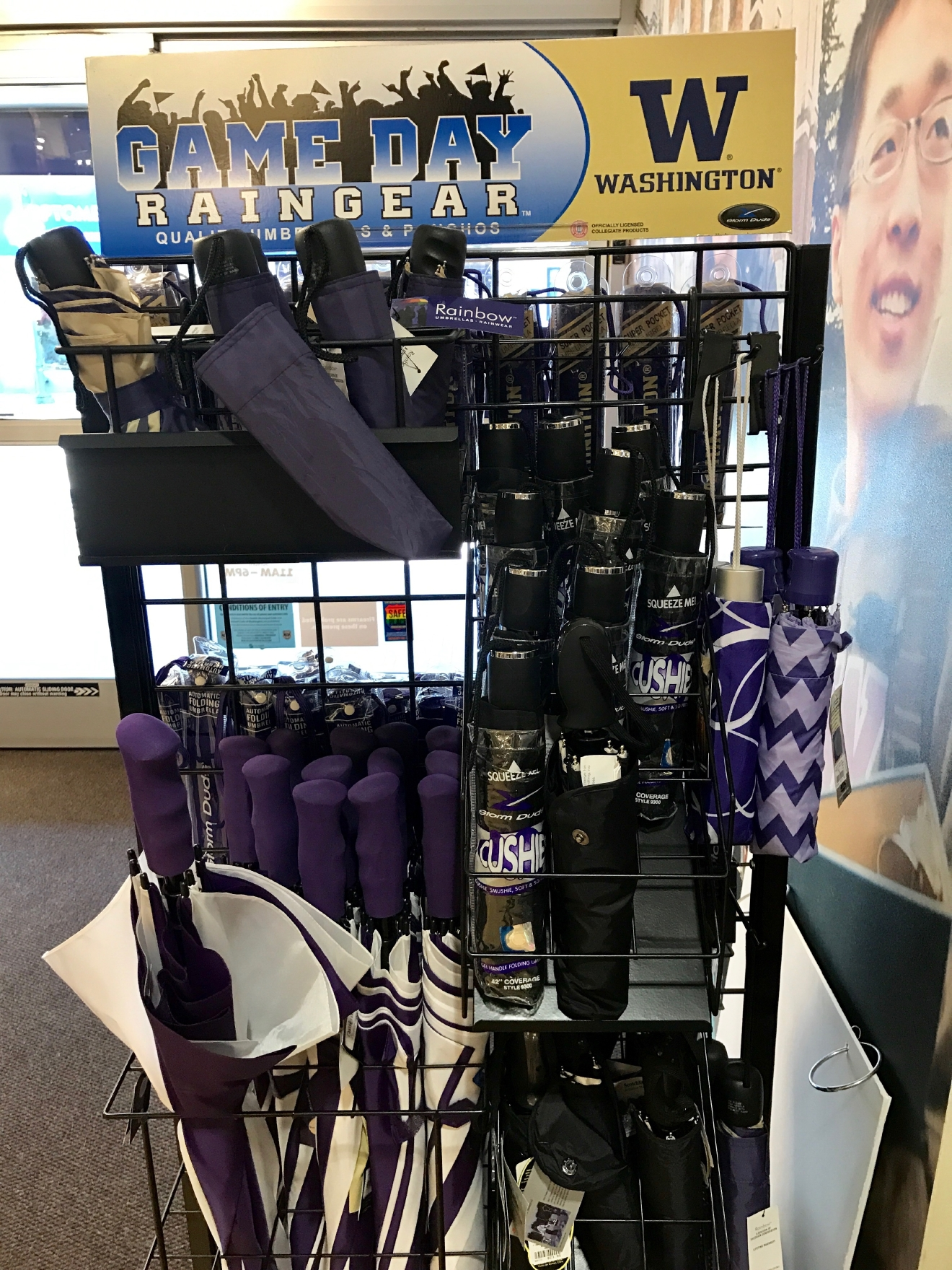 UW Raingear                                          Whether you're a current student, alum, or just *love* the Dawgs, it's a pretty exciting time to be a Husky fan right now. Just to catch you up, the University of Washington football team is having one of their best seasons in years, and will be playing the Peach Bowl in Atlanta on December 31st. If you know a Dawg fan, they're probably salivating at the mouth right about now. Which is why it's a perfect time to give them a themed gift! Here are some of the coolest Husky gear we saw at the University Bookstore on the Avenue during our last visit. Pro Tip: They're open 10 a.m. - 7 p.m. on Christmas Eve! (Image: Britt Thorson / Seattle Refined)